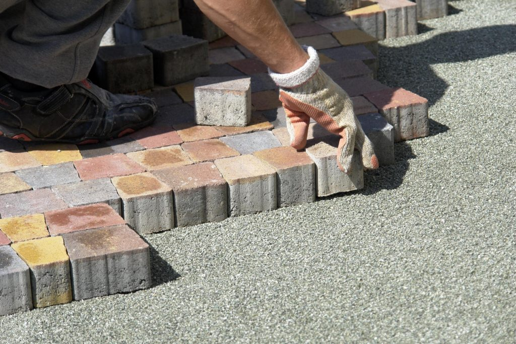 masonry concrete worker paving stones